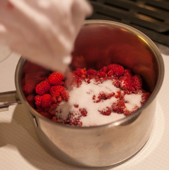 Pouring shot number two. Adding the sugar to the raspberries.