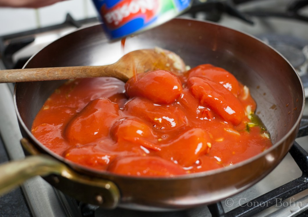 Don't fret, the tomatoes will break down in the cooking.