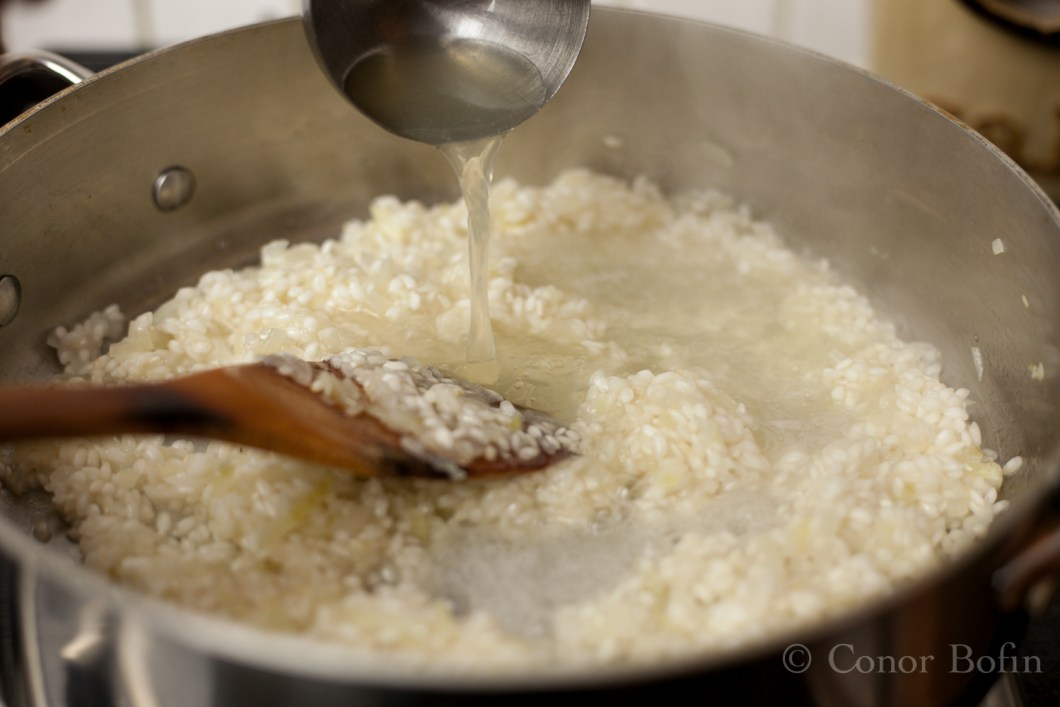 The risotto will slowly start to bulk up as this process goes on.