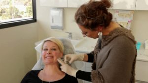 lady getting filler injection