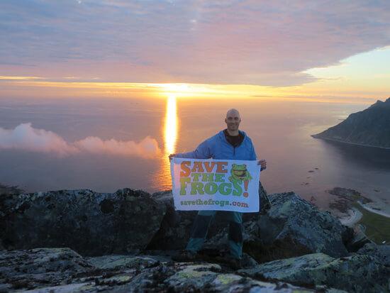 On top of Flakstadting with the midnight sun, Lofoten Archipelago, Norway.