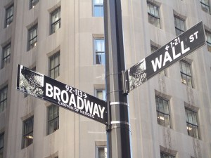 Intersection of Broadway and Wall Street. Why does the Dow keep rising no matter who's in power? Money supply.