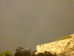 A rainbow, symbol of the covenant of God with man, appears over Jerusalem.