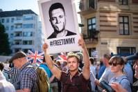 Demonstrators in Copenhagen, Denmark, call for the release of Tommy Robinson.