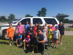 NJ State Park police officer Karl Mott and K9 Kelly, a police dog who finds lost cellphones, wallets, and even people. Campers were able to see her in action and participate in hiding drills.