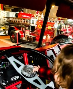 Operate the lights and sirens at the Cincinnati Fire Museum