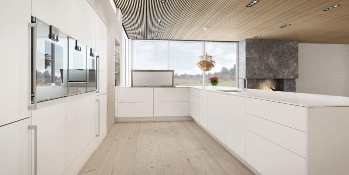Modernité, convivialité et gain de place décrivent cette cuisine en U.