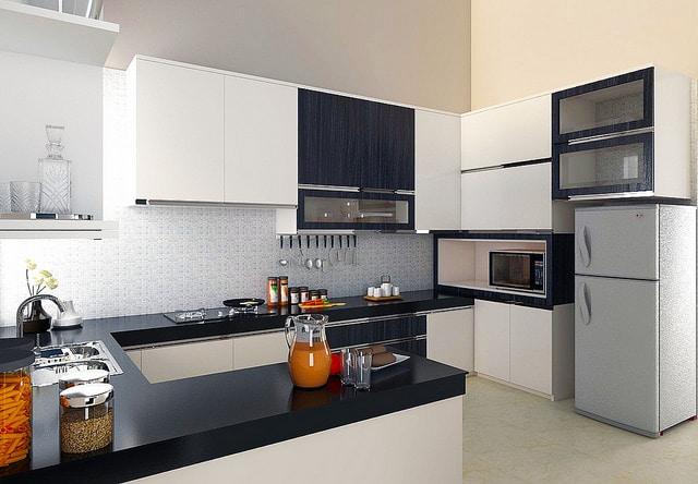 petite cuisine moderne en U avec plan de travail synthétique noir