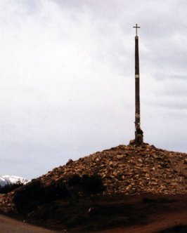 La Crux de Ferro, the iron cross at the highest point of the camino between Rabanal and Molinaseca. Pilgrims traditionally leave a stone or some other object bearing their names on the pile at the foot of the cross.