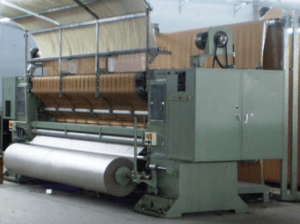 cut and loop tufting machine