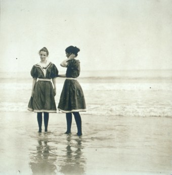 Two sisters, Dorothea and Maryal Knox, wearing the typical swimming attire for women the early 20th century. They stand in the surf at Rye Beach, NY, ca.1900. Image courtesy of Schlesinger Library, Harvard University.