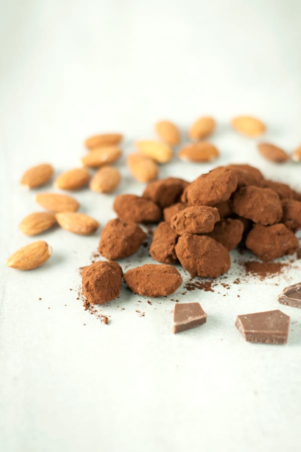 Chocolate covered caramel almonds- roasted almonds are covered with a crunchy caramelized shell, dipped in milk chocolate, and dusted with cocoa powder.