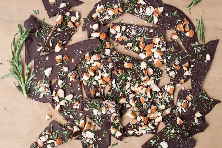 Rosemary Bark- This ultra thin dark chocolate rosemary bark is loaded with sea salt, roasted almond pieces, and chopped fresh rosemary.