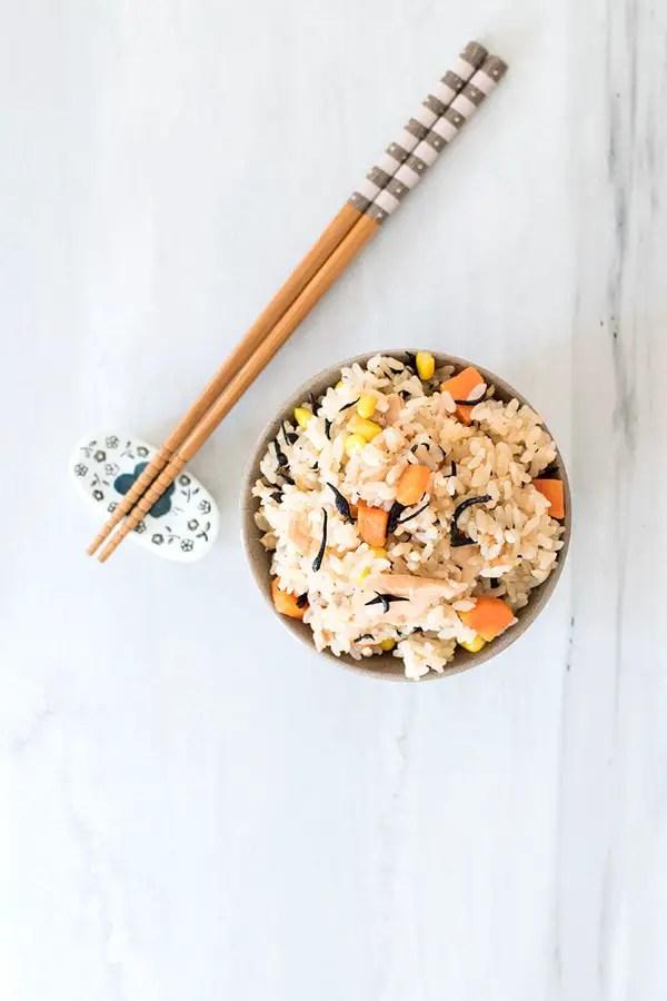 Top view of tuna takikomi rice with chopsticks.