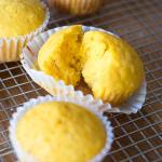 Kabocha squash muffin torn open to see fluffy inside.