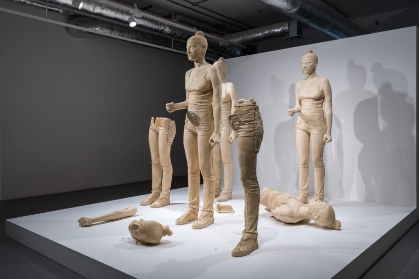 Simon Fujiwara, Rebekkah (2012), Five terracotta dyed, life size, cast plaster female figures and video, dimensions variable. Installation photograph at the Contemporary Art Society, 2014. Courtesy Joe Plommer.