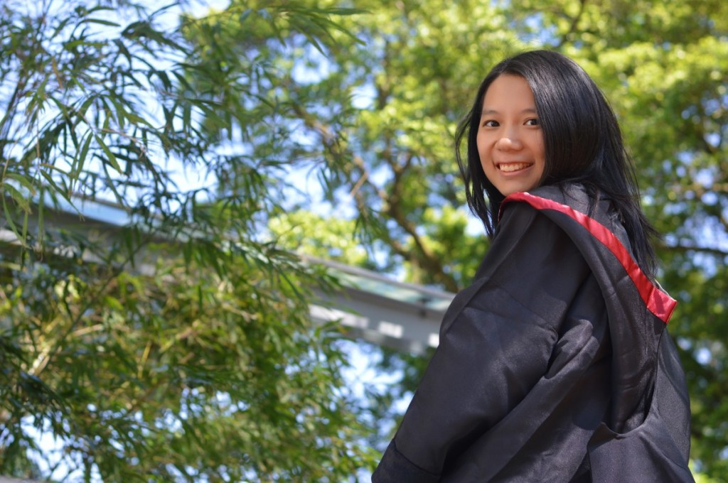 Asian female in graduation robe