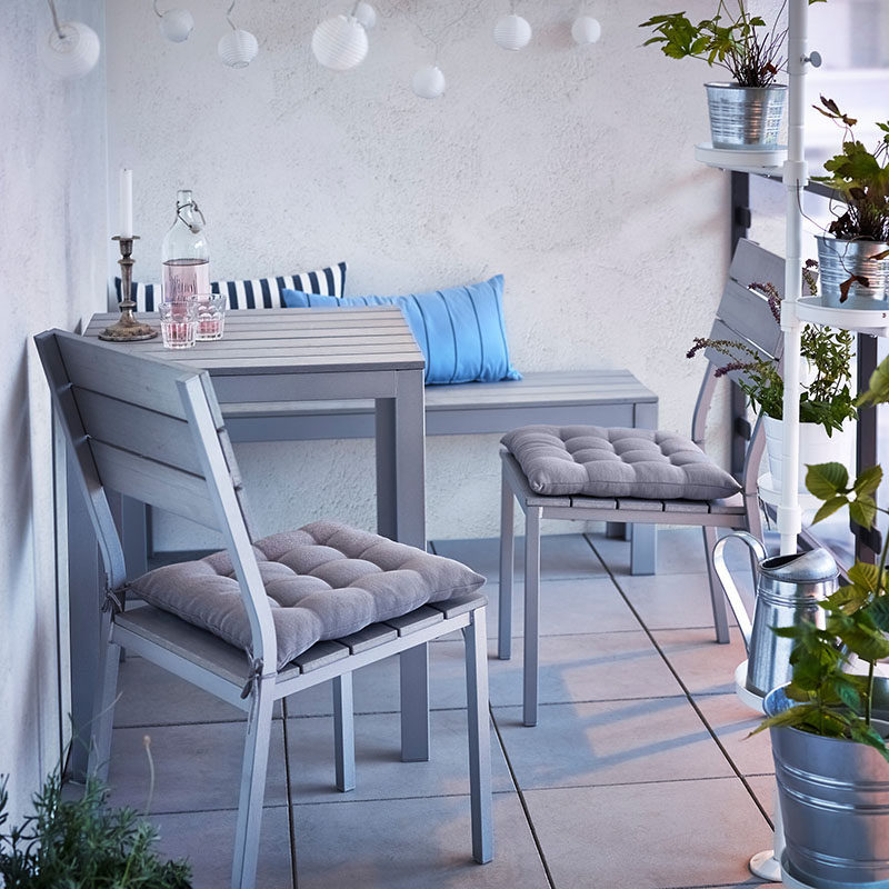 How To Make Your Balcony Awesome For Summer // Think about a small table and chair set, or if you don't have the room for a table, perhaps a bench would be better?