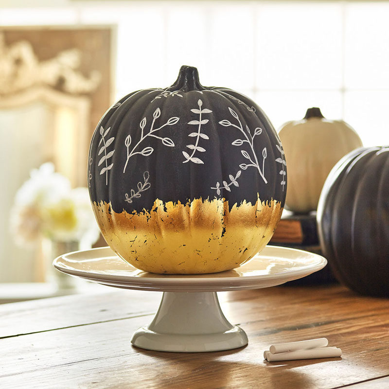 13 Modern DIY Halloween Pumpkin Ideas // Use chalkboard paint and gold foil to make pumpkins that can be changed whenever the mood strikes.