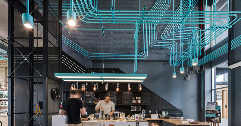 Turquoise Electrical Conduit Is A Design Feature Running