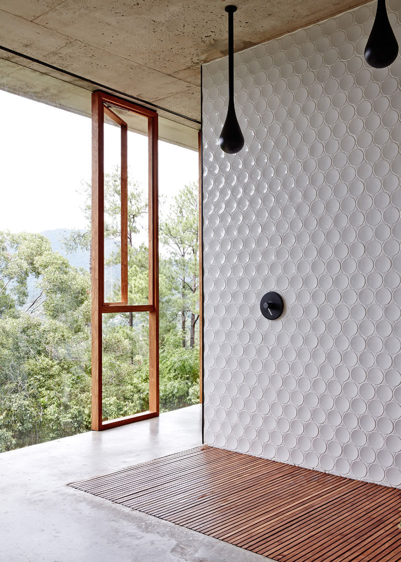 Bathroom Tile Ideas - Install 3D Tiles To Add Texture To Your Bathroom // These slightly concave circular tiles have just enough curve to them to keep them from looking flat and are a nice modern contrast to the concrete and wood used throughout the rest of the bathroom.