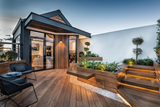 ANA arquitectura have designed a modern rooftop terrace for their clients that wanted a refuge in the heart of the city that they could relax in.