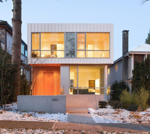 This modern home in Vancouver, Canada, has an exterior of wood (Douglas Fire), aluminum and large glass windows.