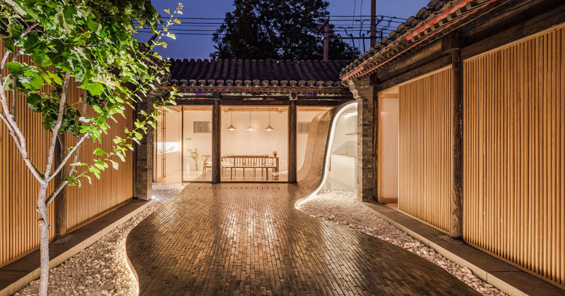 This Renovated Historical Residence Features Tile Flowing From The Roof To The Courtyard
