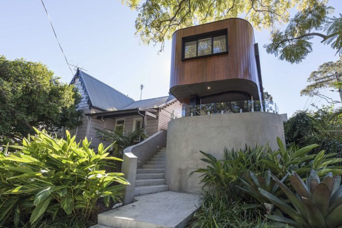 This modern curved wood and concrete house is located in Sydney, Australia, and features indoor/outdoor living. #Architecture #Australia #Landscaping #Wood #Concrete