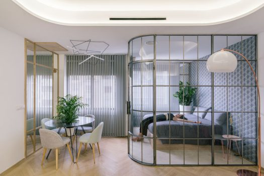 This modern bedroom is separated from the rest of the apartment by a framed glass wall. #GlassWall #BedroomDesign #FramedGlassWall #InteriorDesign #ModernBedroom
