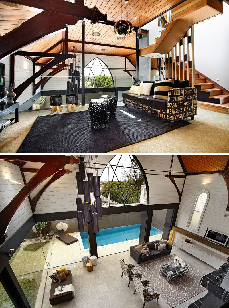 This modern church conversion has a mezzanine level that's home to a rumpus room and that overlooks the living room void and and has valley views through the large arched window. #ChurchConversion #Mezzanine
