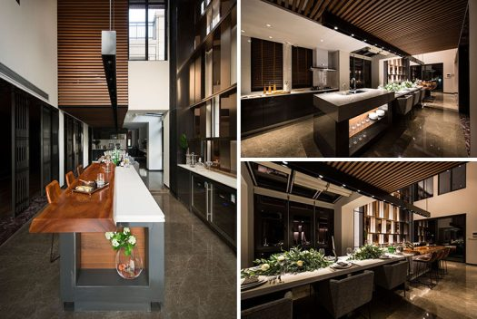 This long and modern kitchen island is home to a bar, a six person dining table and a food prep area. #KitchenIsland #ModernKitchen