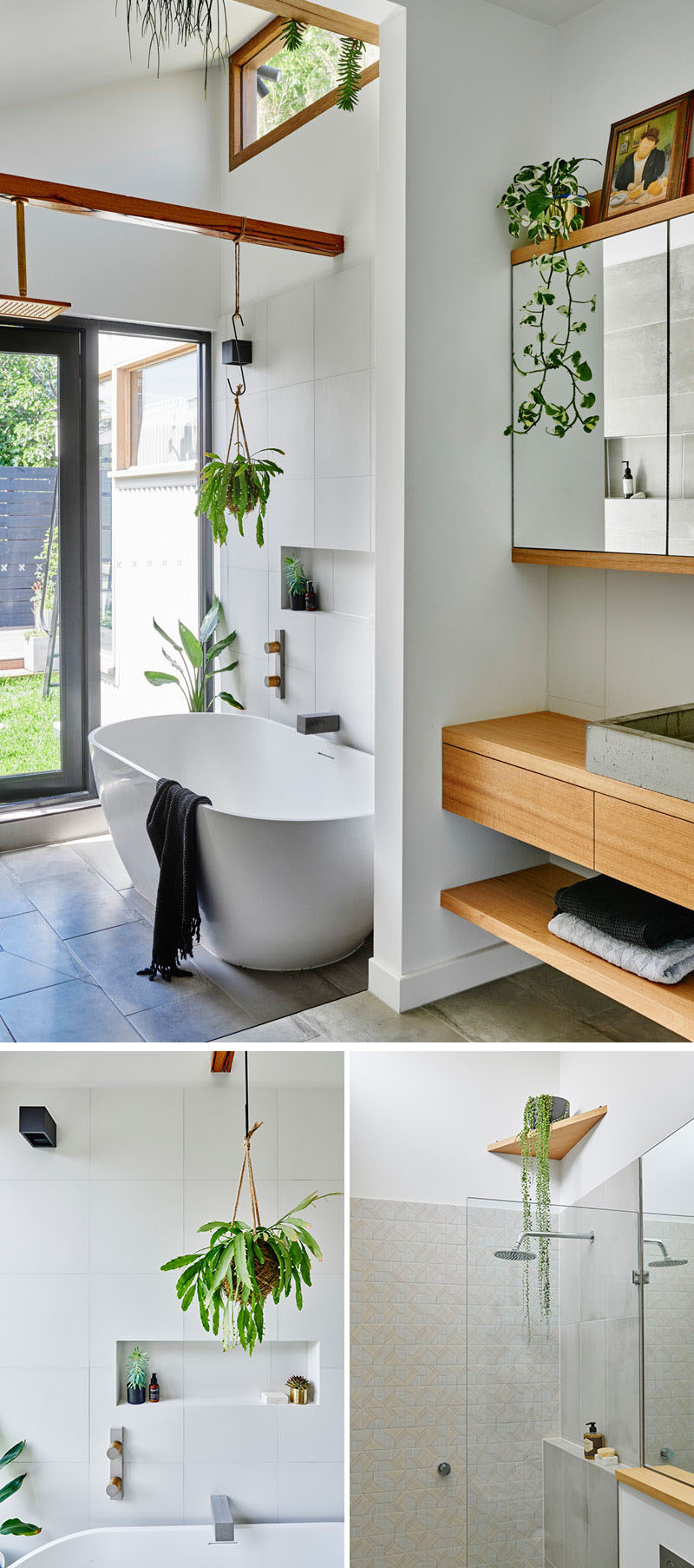 In this modern updated bathroom there's a freestanding bathtub with views of the backyard, while wood elements and plants add a natural touch to the space. #ModernBathroom #WhiteAndWood