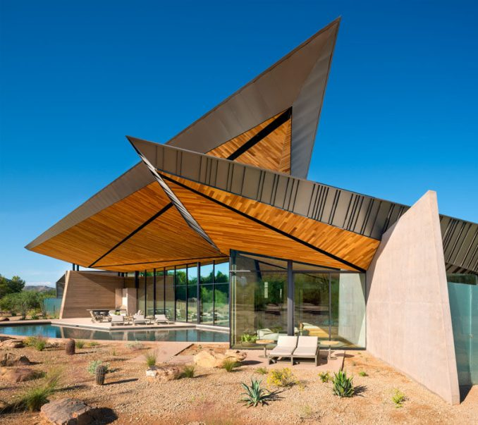 Kendle Design Collaborative were inspired by desert forms, indigenous materials, natural light, and mountain views, when they designed this house inParadise Valley, Arizona. #ModernHouse #ModernArchitecture #Sculptural
