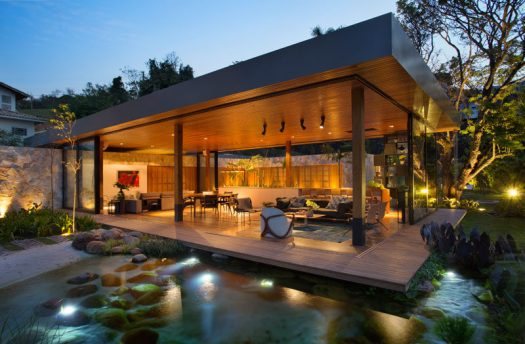 Studio Otto Felix has recently completed a modern house in Sao Paulo, Brazil, that featuresneutral colors and natural materials throughout its design. #Architecture #IndoorOutdoor #ModernHouse #NaturalPool #Landscaping
