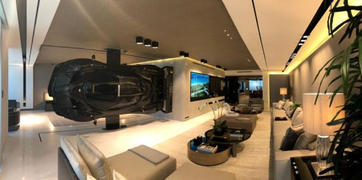 This modern oceanfront condo in Miami has a Pagani Zonda R racing car installed as part of the decor, that serves as a high-impact partition between the living room and master suite. #RacingCar #RoomDivider #ModernInterior