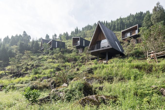 A collection of modern holiday cabins in Guizhou, China, surrounded by farmland, have been designed with shou sugi ban (blackened wood) facades. #Cabins #Hotel #Architecture