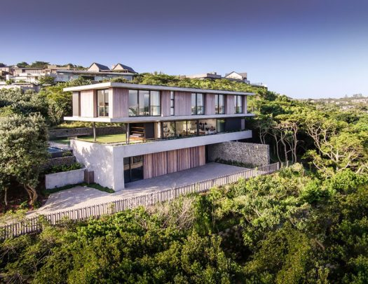 Bloc Architects has designed 'The Tree House', a new contemporary house that's surrounded by one of Durban's few remaining indigenous coastal forests. #ModernHouse #HouseDesign #ModernArchitecture