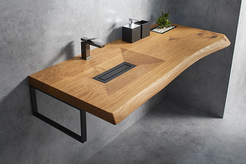 Cone Invi is a modern yet natural bathroom vanity that's made from a single piece of solid wood, with a basin machine-carved out of its surface.#WoodVanity #ModernBathroom #ModernVanity