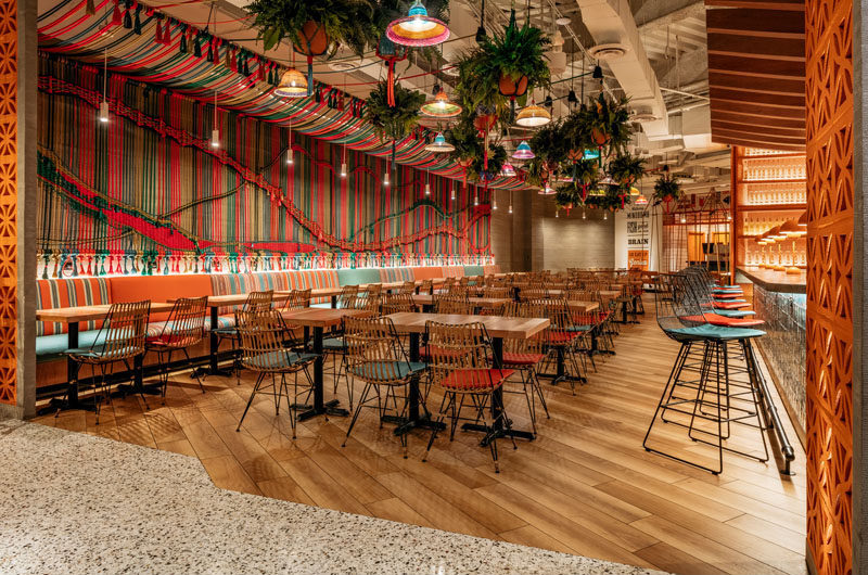 Restaurant Ideas - One of the main design elements in this new Miami restaurant, is a wall that's adorned with a multi-color handwoven macramé rope mural. #Mural #Art #RopeMural #Macrame #RestaurantIdeas