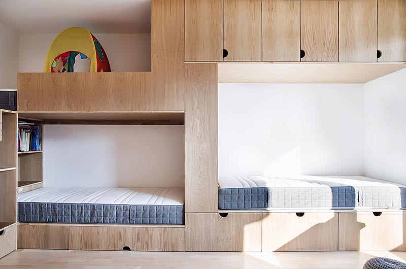 This Children S Bedroom Has A Bunk Bed Built For Three