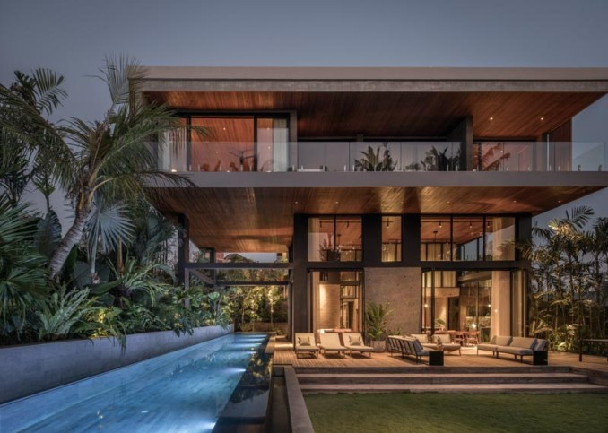 Architect Alexis Dornier has completed 'The River House', a modern home in Pererenan, Bali, that uses reclaimed timber and locally sourced sandstone throughout its design. #ModernHouse #ModernArchitecture #HouseDesign #SwimmingPool #OutdoorSpace