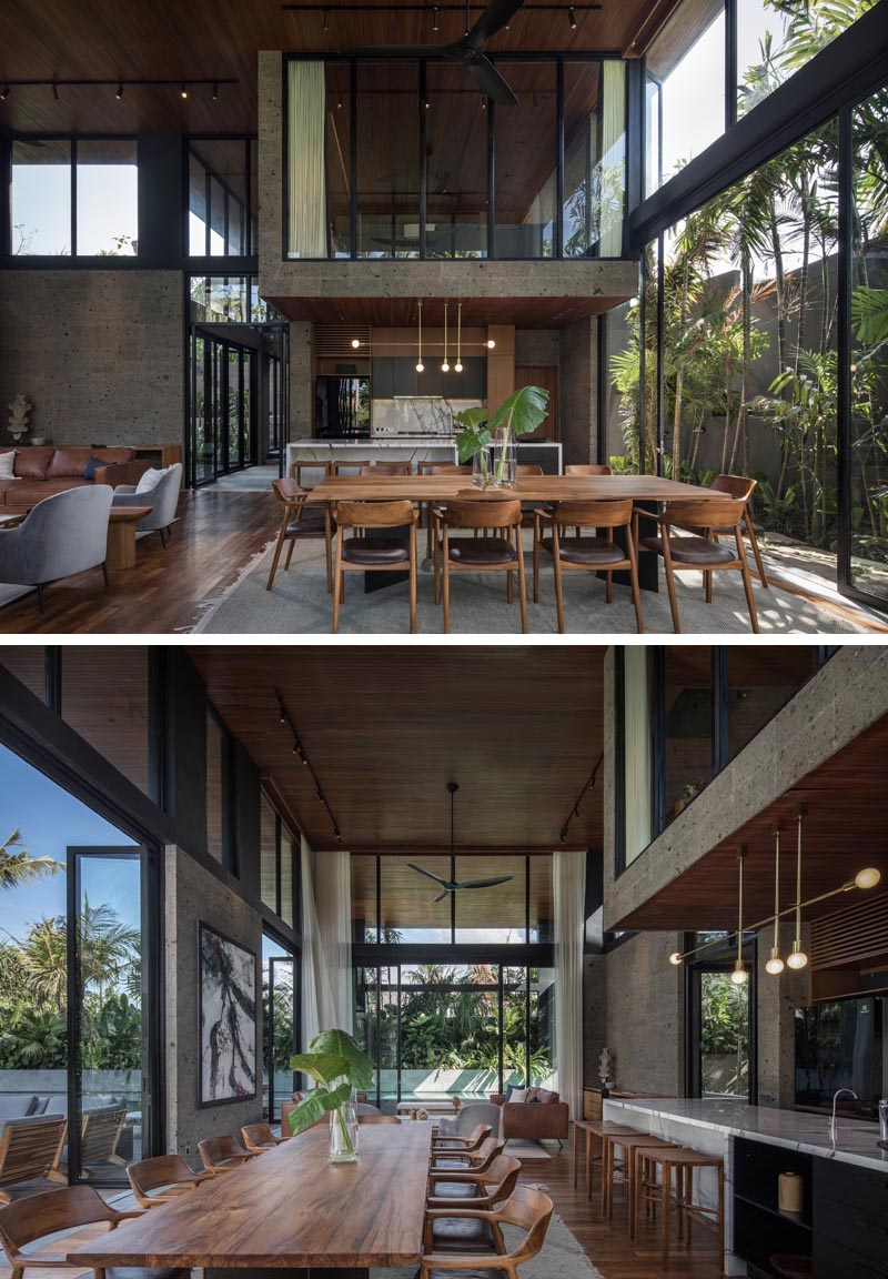 Wood furnishings inside this modern house complement the wood ceiling that travels through to the exterior and creates a partially covered outdoor entertaining space. #WoodCeiling #OpenPlanInterior #ModernInterior #ModernHouse