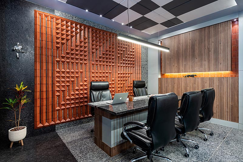 Using a variety of custom terracotta tiles, the designers were able to create a unique large wall art installation that adds interest to the office and complements other tile work found throughout the office. #WallArt #OfficeDesign #TileArt #TerracottaTiles