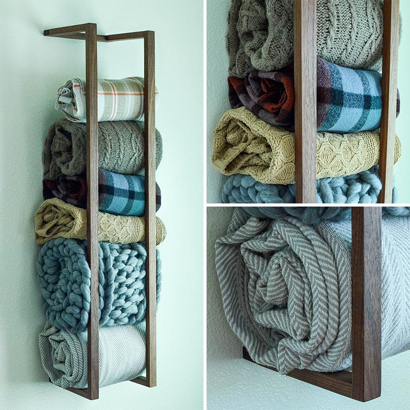 If you don't have any floor space, a great way to add extra storage is to look at your walls for room. A blanket shelf attaches to your wall and holds your blankets, rolled up, until you need them. This is also a great way to show off your blanket collection. #BlanketShelf #BlanketStorage #HomeDecor #ModernDecor