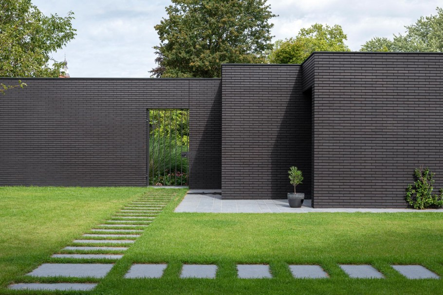 Modern house with a black brick exterior