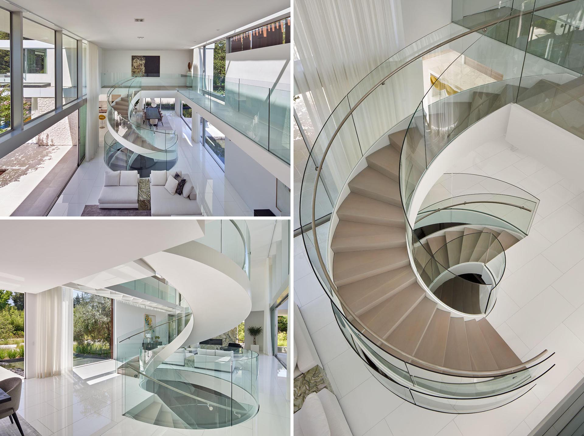 This custom designed spiral staircase includes glass handrails and a steel frame that complements the surrounding white walls.