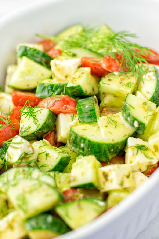 I recommend an Italian dressing for the Cucumber and Tomato Salad.