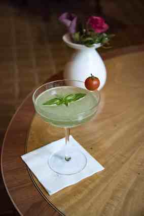 The Regent, 5-Star Hotel in Berlin - Basil gin cocktail with a cherry tomato as garnish