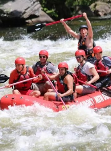 Ricky Joshi (foreground) whitewater rafting in Tennessee